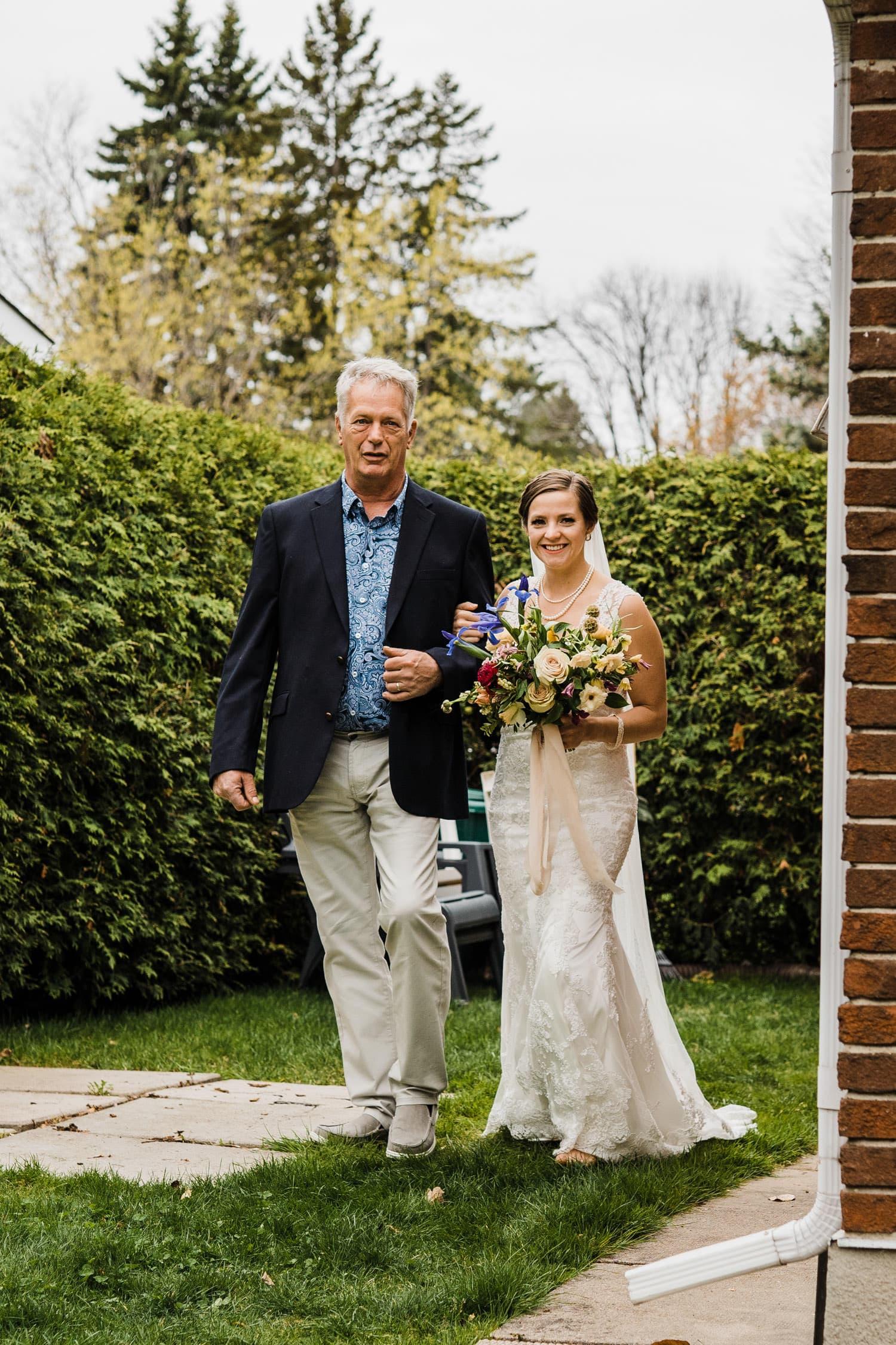 bride and father walk to ceremony - small backyard wedding ottawa