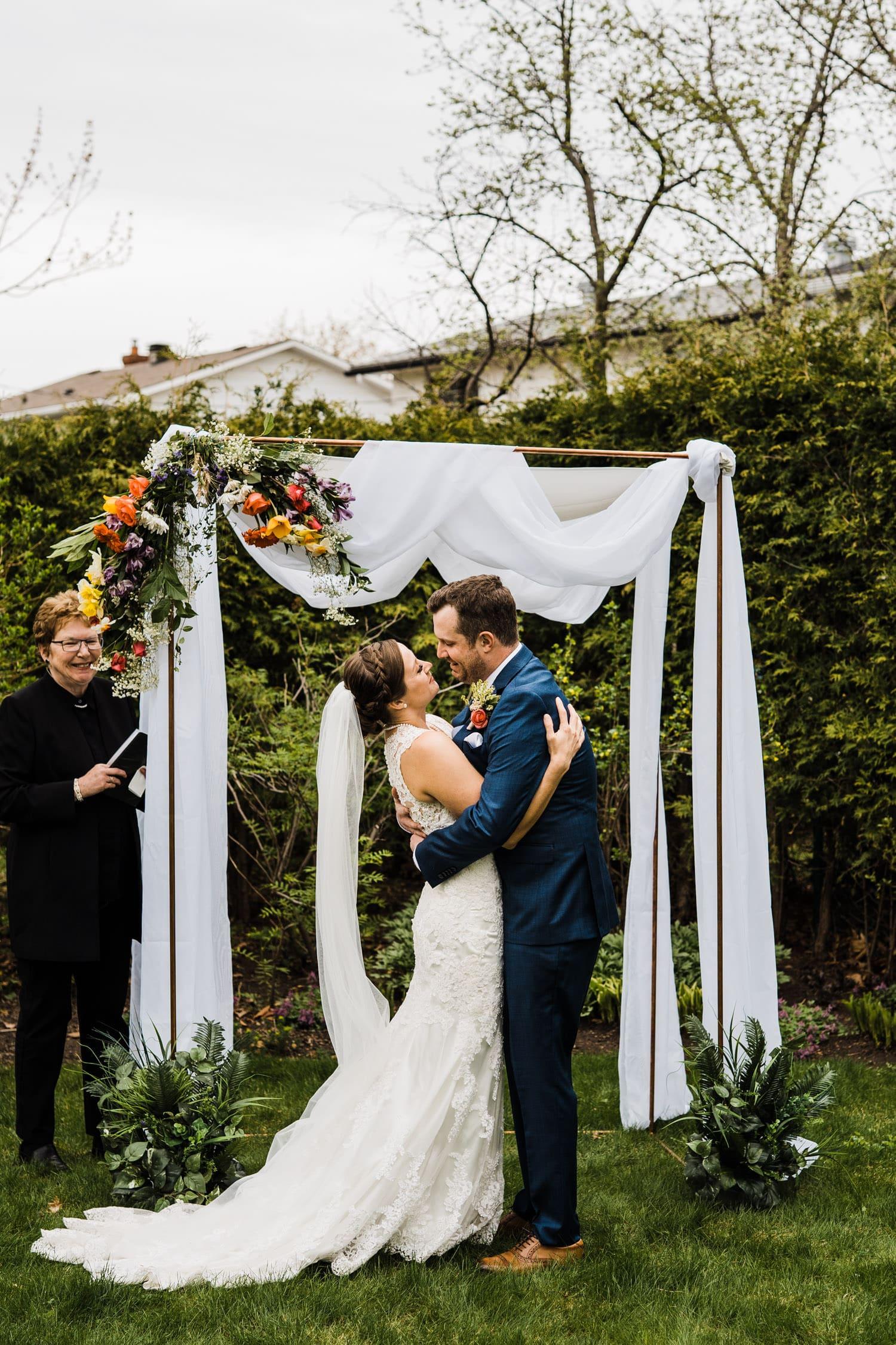 first kiss during intimate backyard ceremony - small backyard wedding ottawa