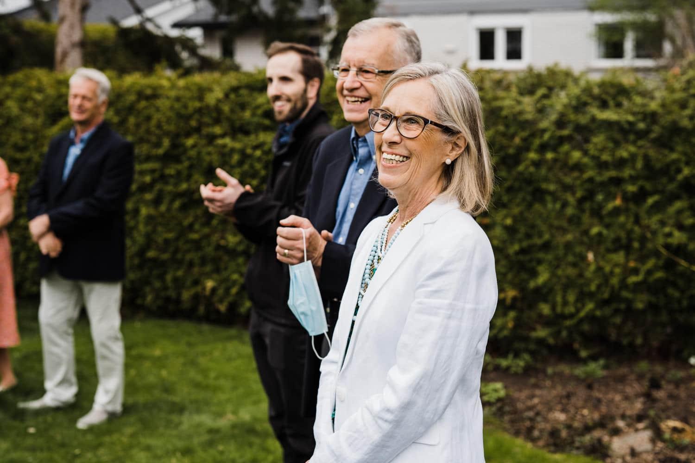 family celebrates after intimate backyard ceremony