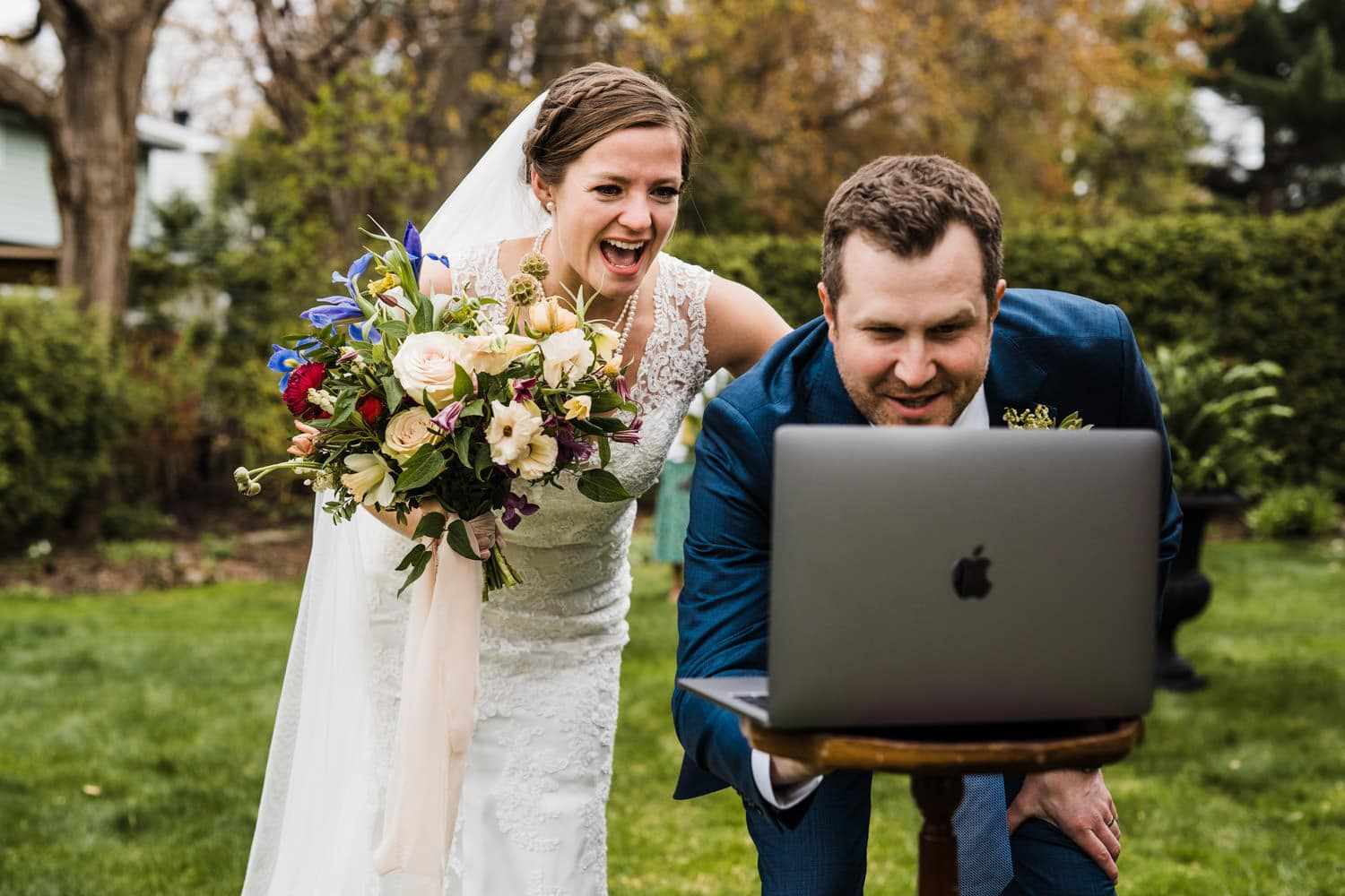 couple chats with their livestream guests after ceremony - intimate backyard wedding