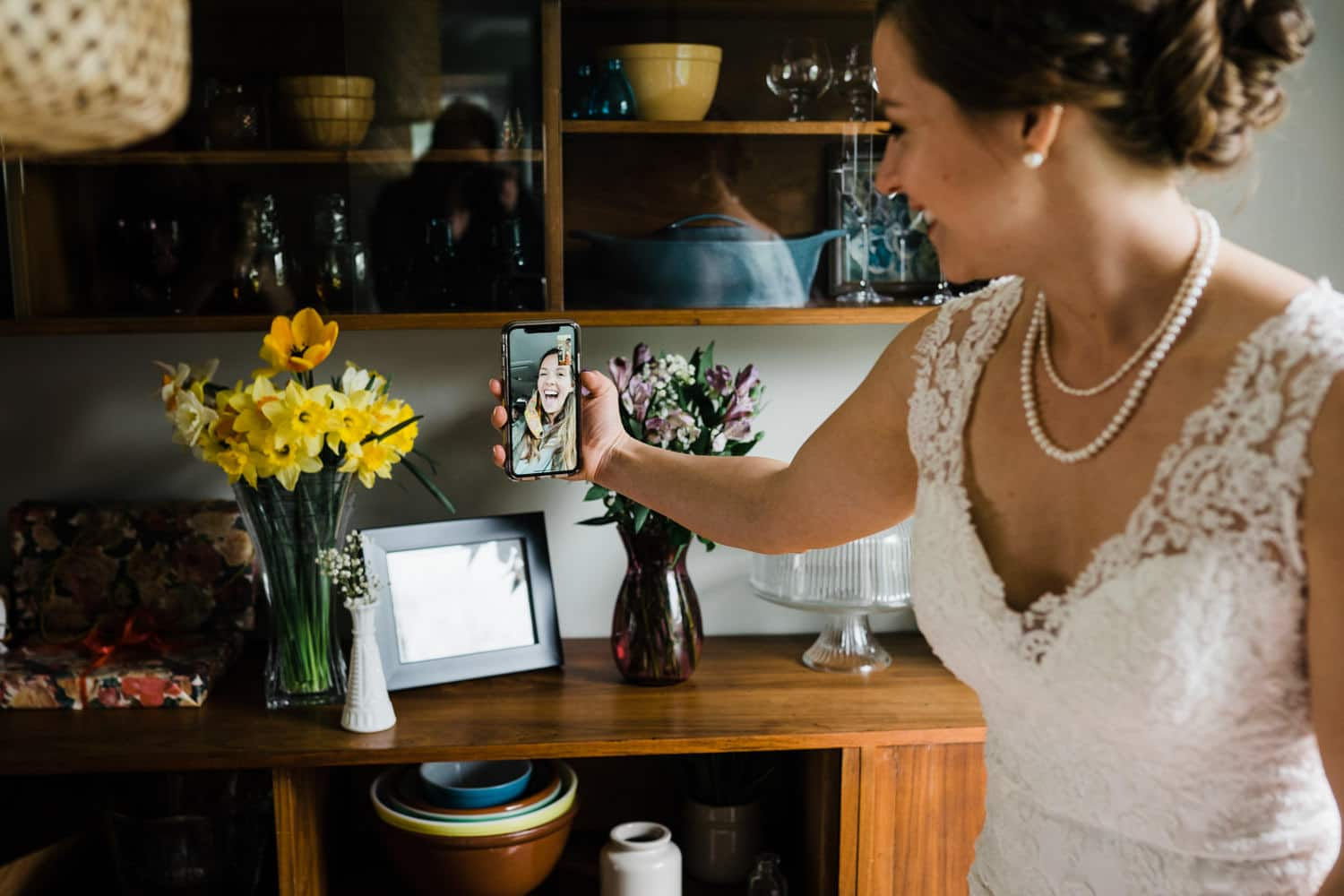 bride facetimes with her sister before wedding ceremony