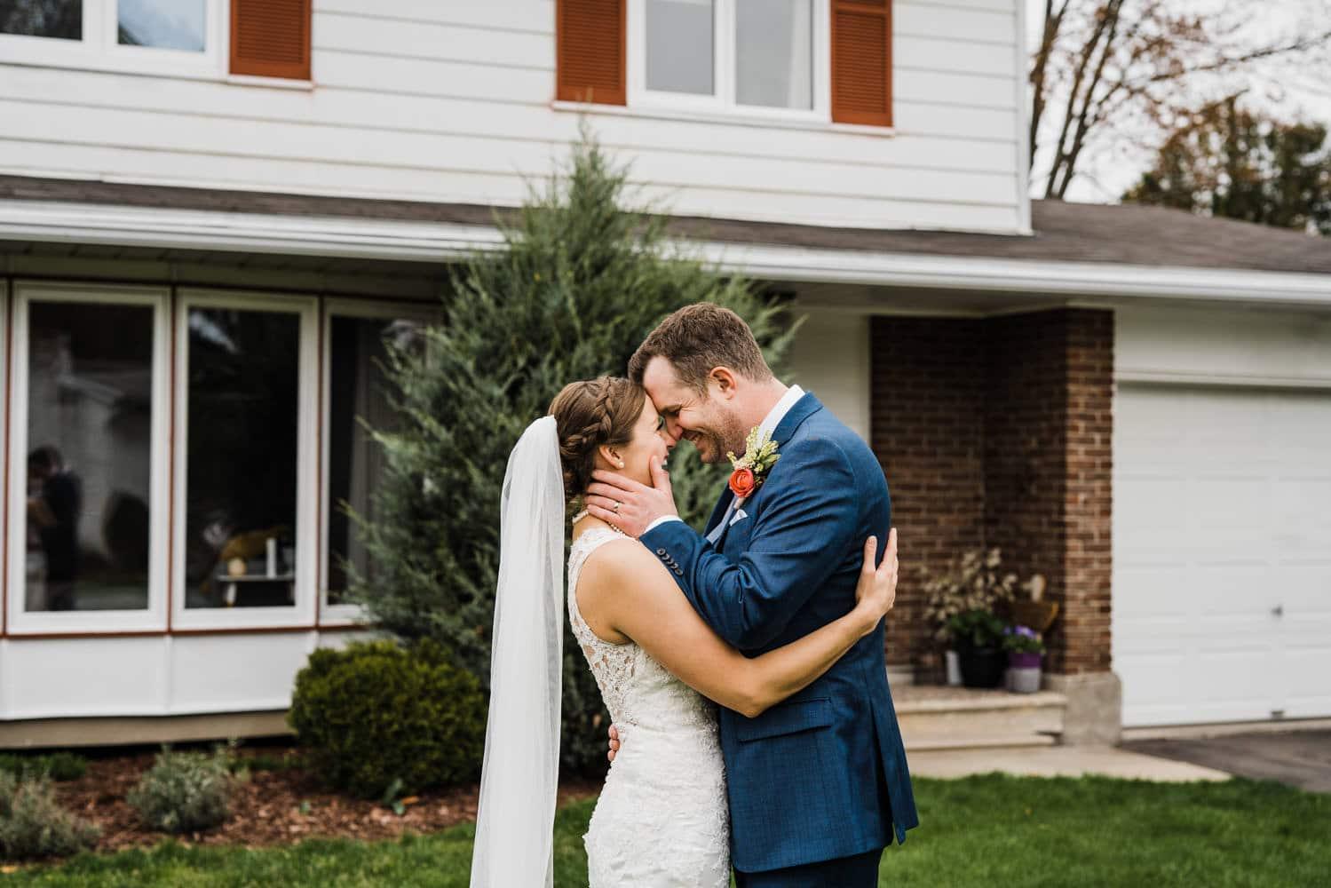 couple laugh after their backyard wedding ceremony - intimate wedding ottawa