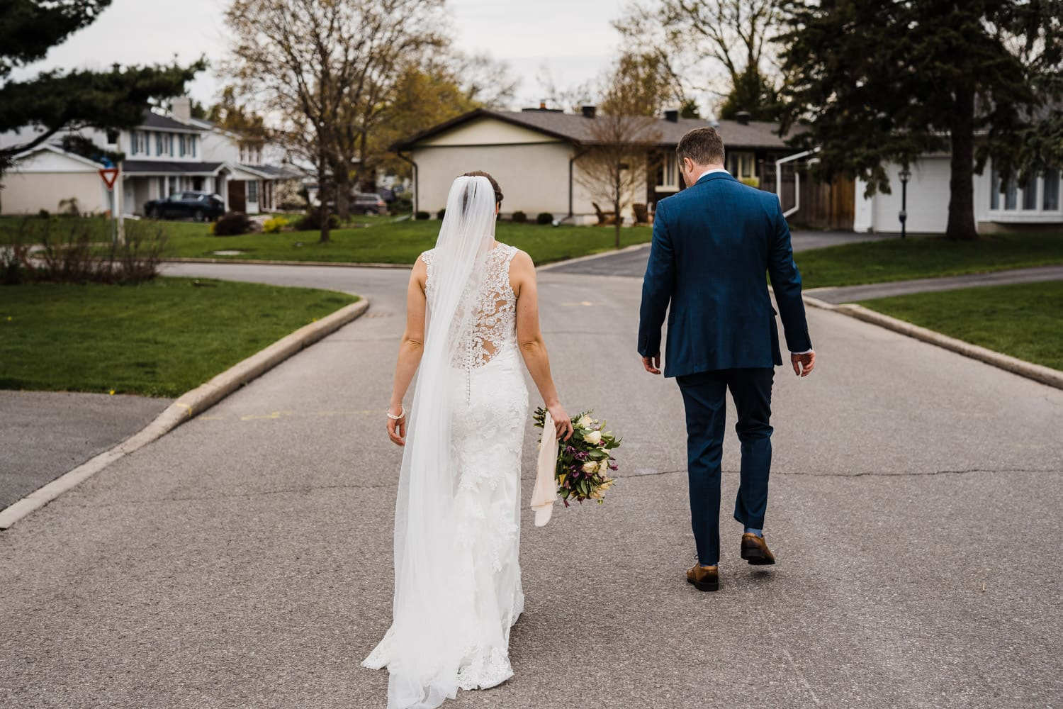 couple walk down their street together