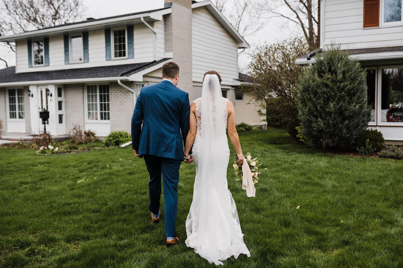 couple walk to their backyard together - intimate wedding ottawa