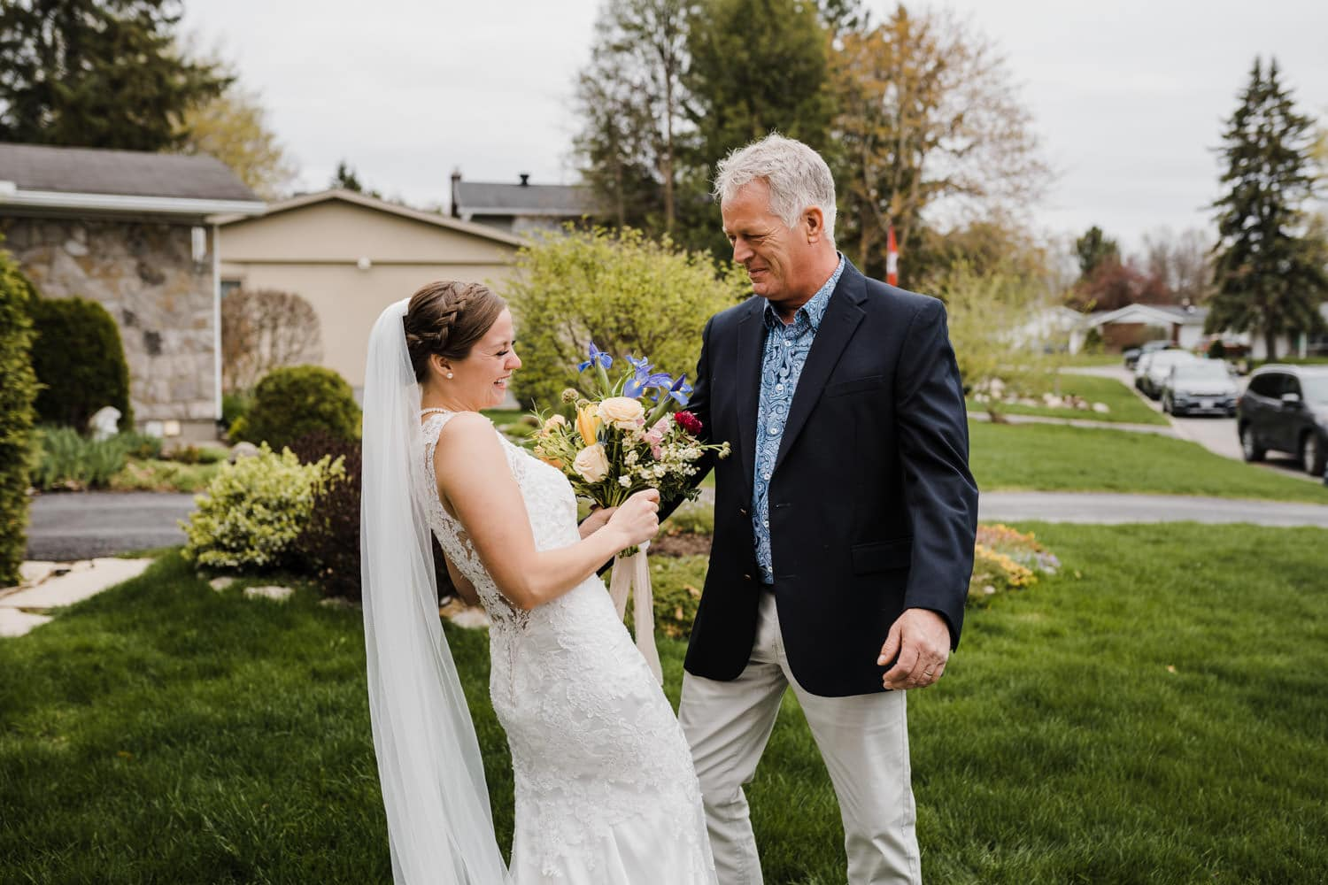 bride and her father cry when they see each other for the first time on wedding day