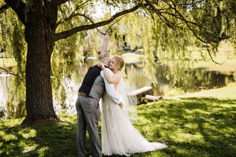 couple hug under willow tree in stewart park