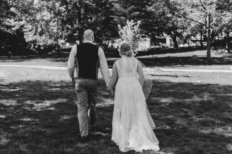 couple walk hand in hand through park
