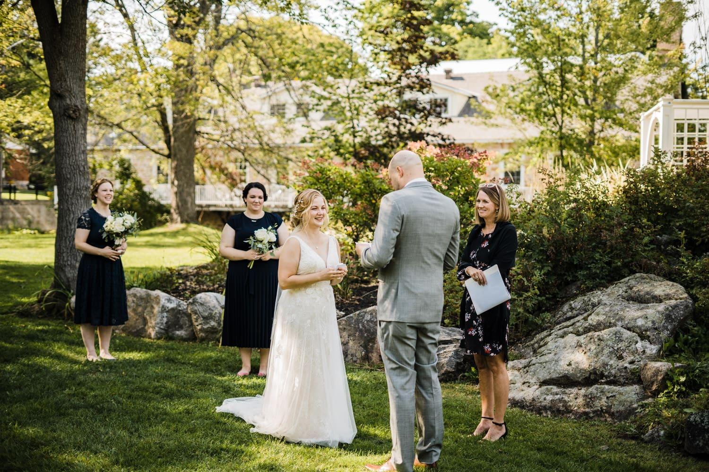 bride laughs during wedding ceremony - small stone cellar wedding perth - stewart park