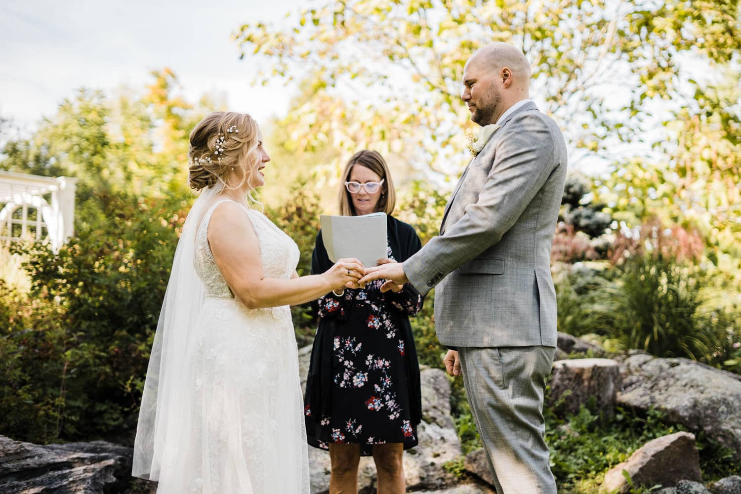 couple exchanges ring during wedding ceremony - stewart park perth