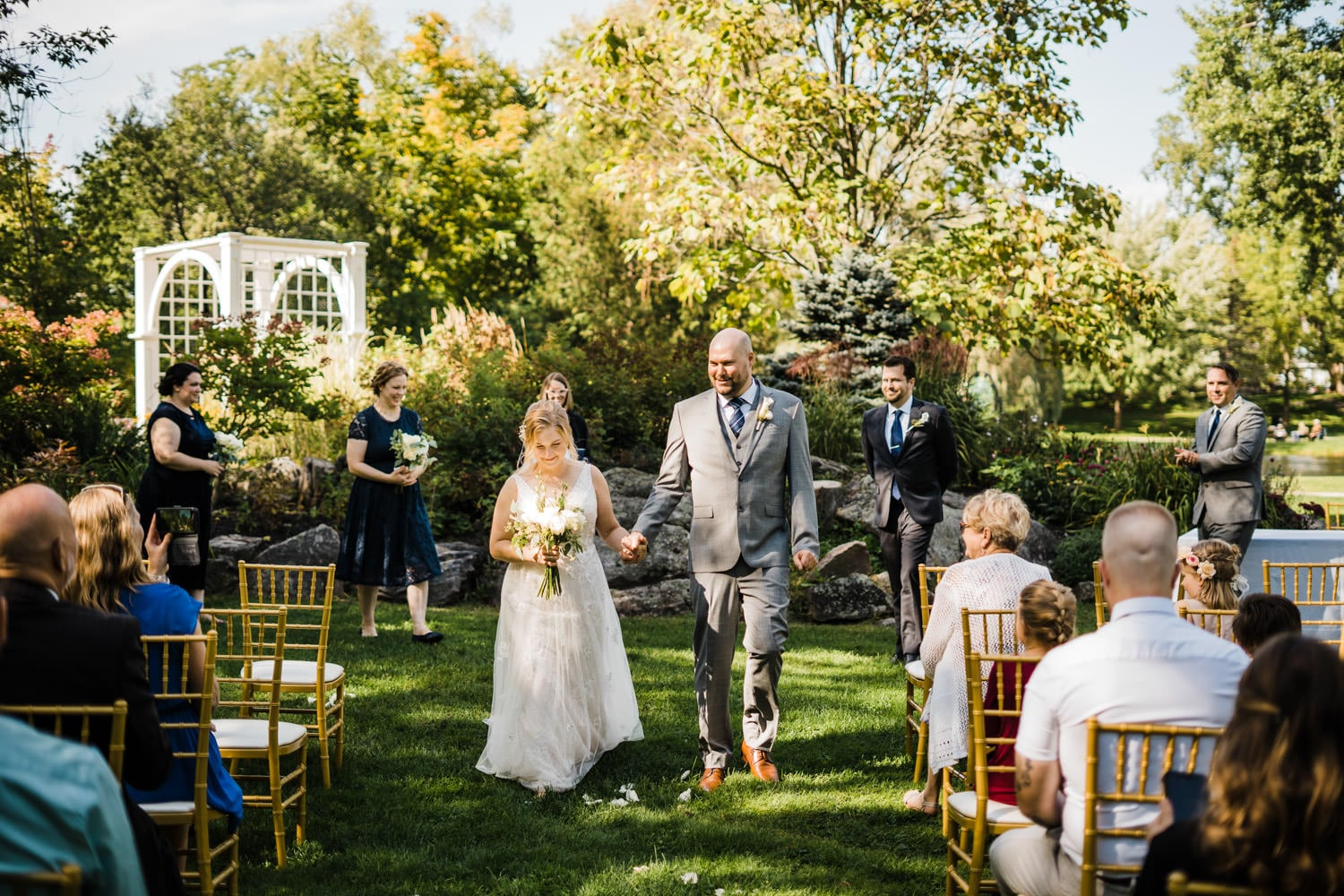 couple walk down aisle after stewart park ceremony in perth