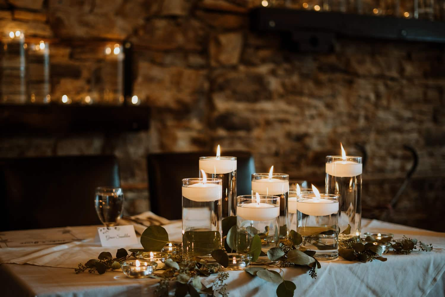 head table decorated with candles - small stone cellar wedding