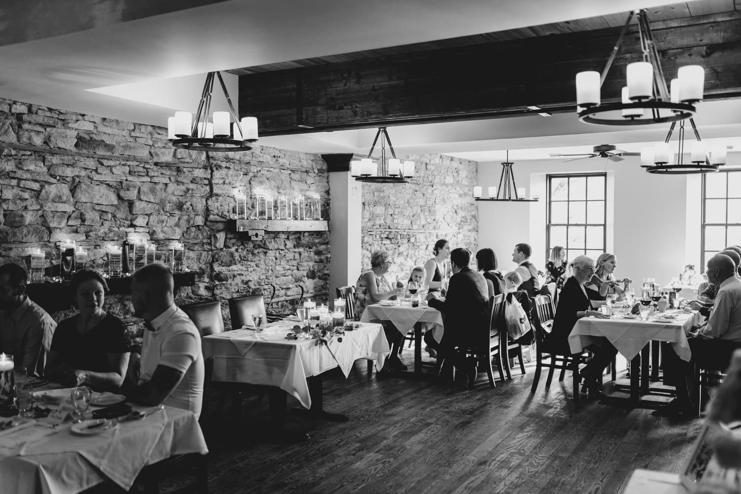 guests are seated at the stone cellar for wedding reception