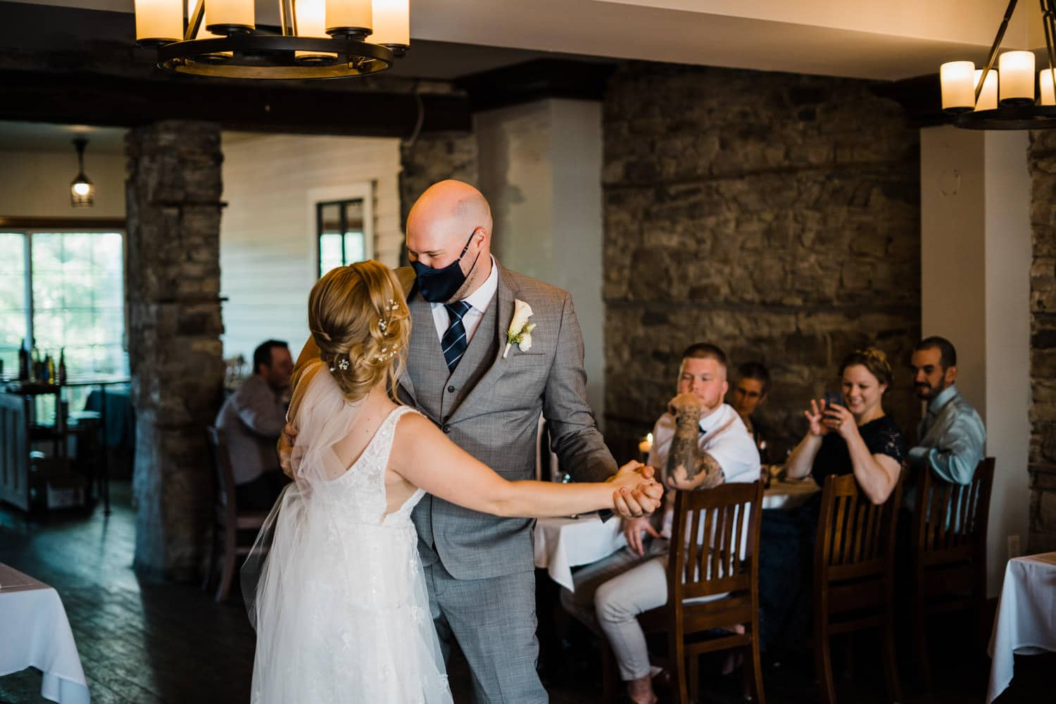 couple have their first dance at stone cellar in perth