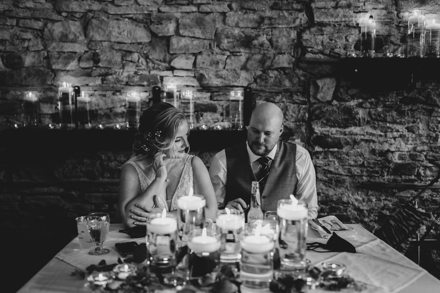 couple seated at their head table - stone cellar perth
