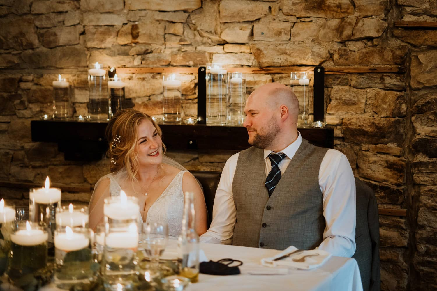 couple laugh during their reception at the stone cellar in perth