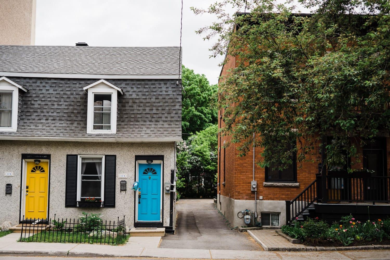 Duplex home with bright blue front door