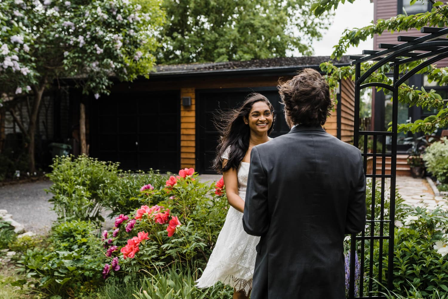 bride laughs with groom during ceremony - small backyard ceremony ottawa