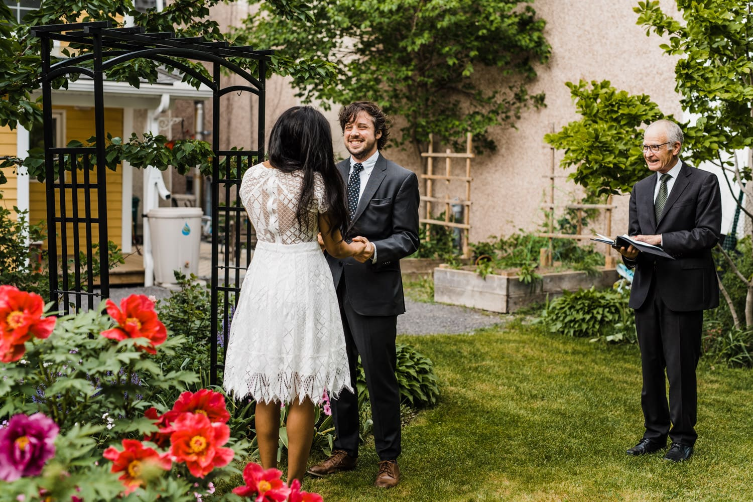 couple laughs together during small backyard ceremony - ottawa elopement