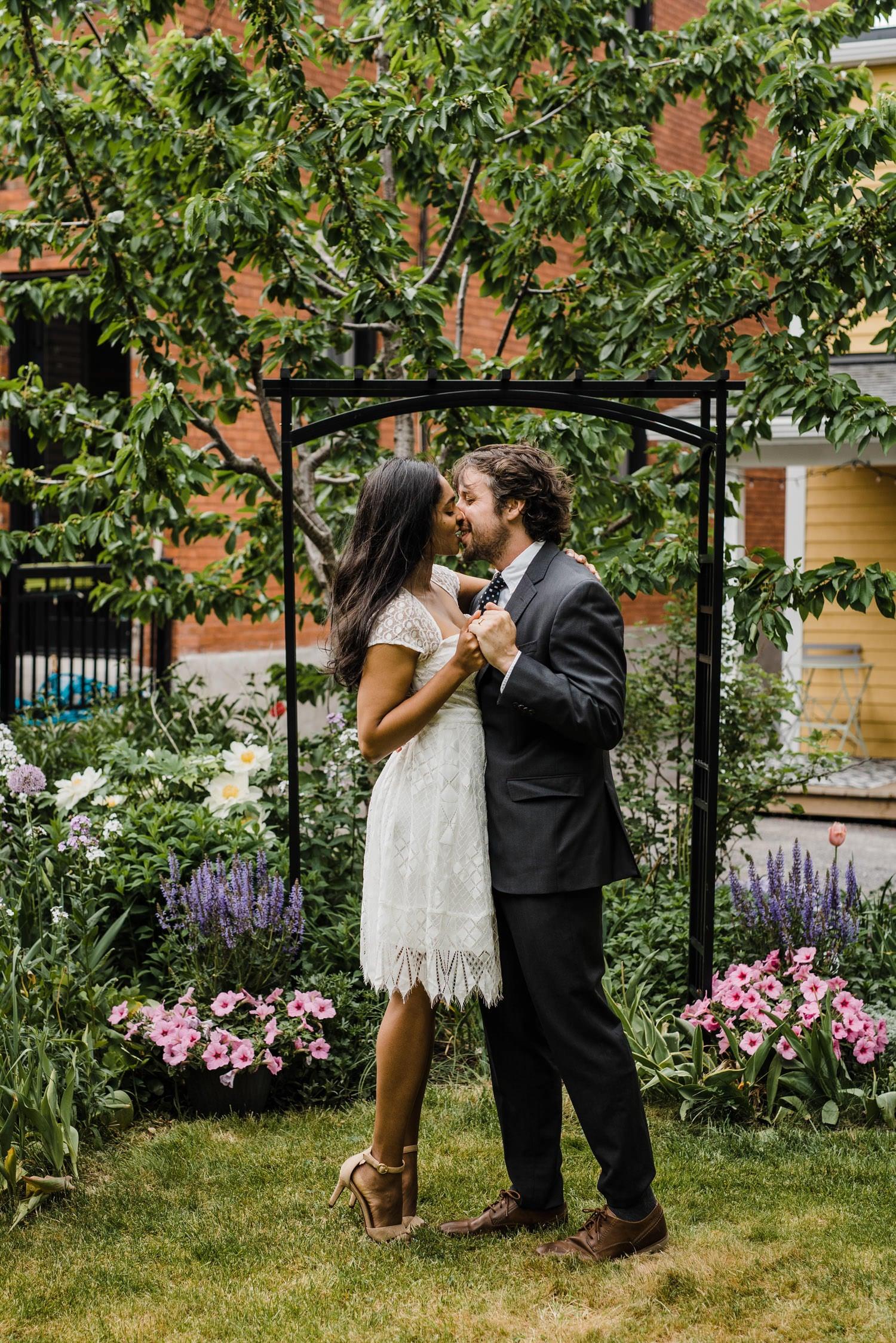 first kiss during backyard elopement