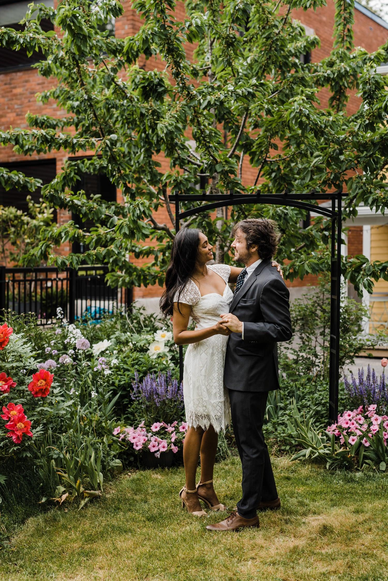 couple celebrate intimate backyard garden ceremony