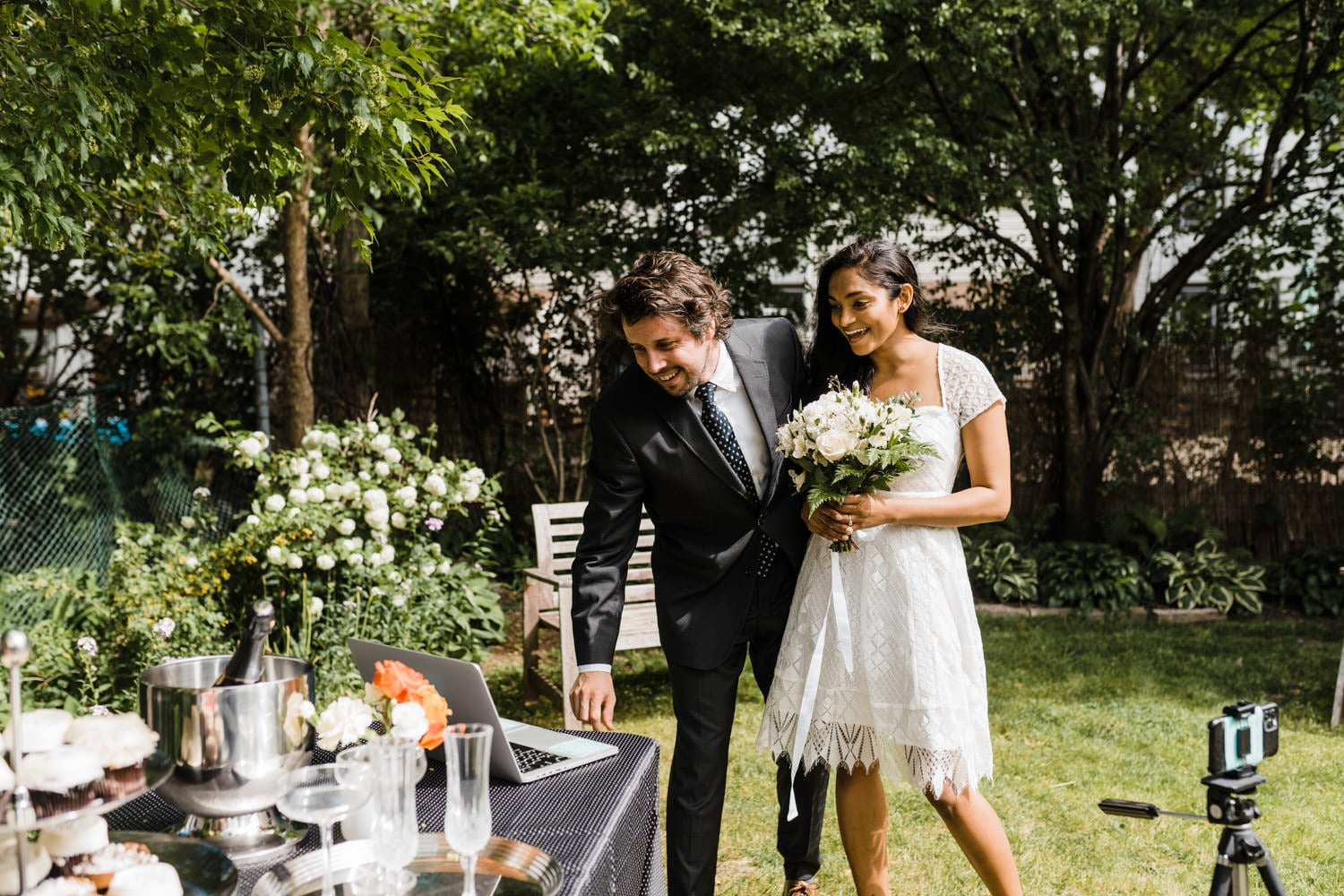 couple chat with their families via livestream after their backyard ceremony