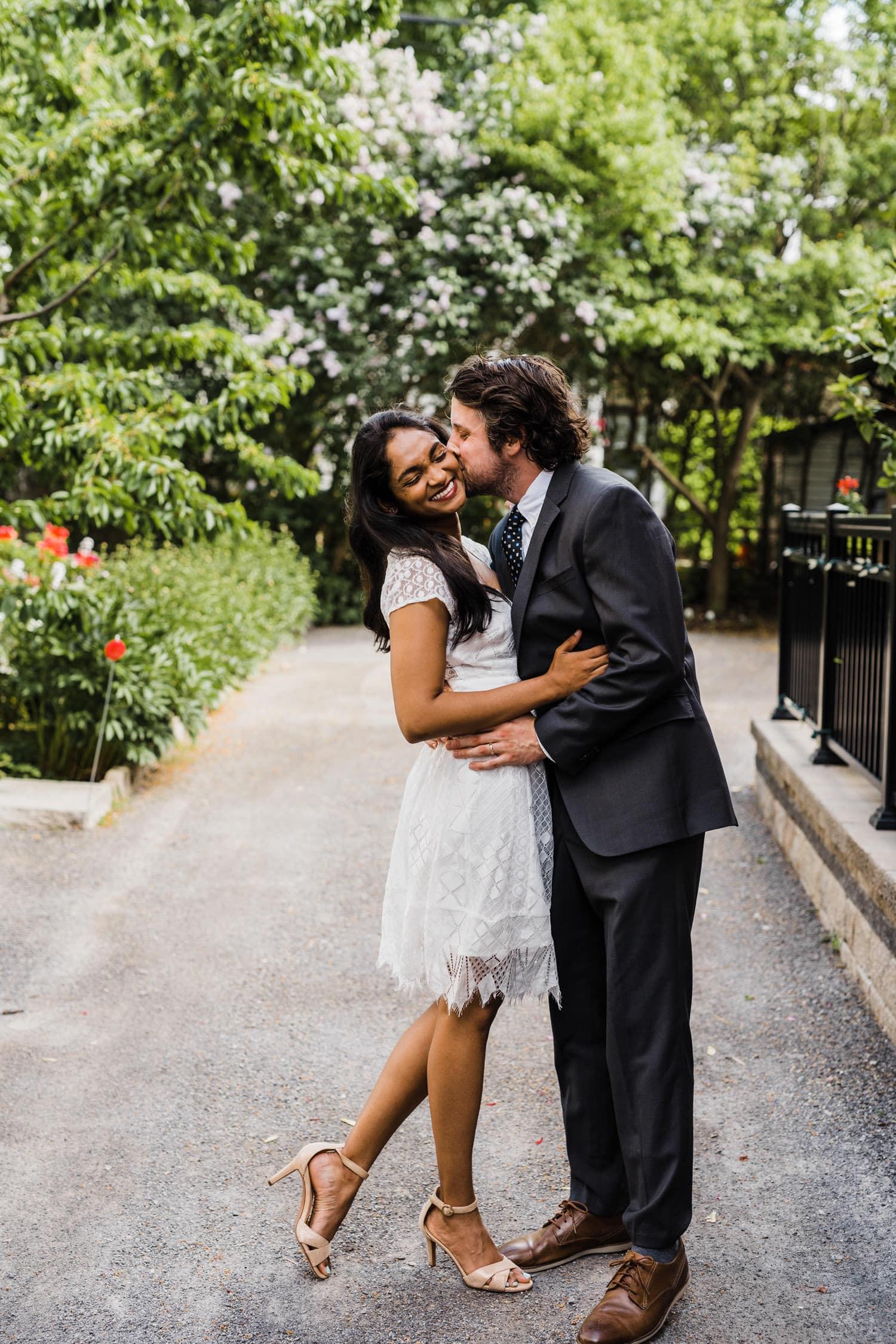 groom kisses brides cheek - small backyard ceremony ottawa