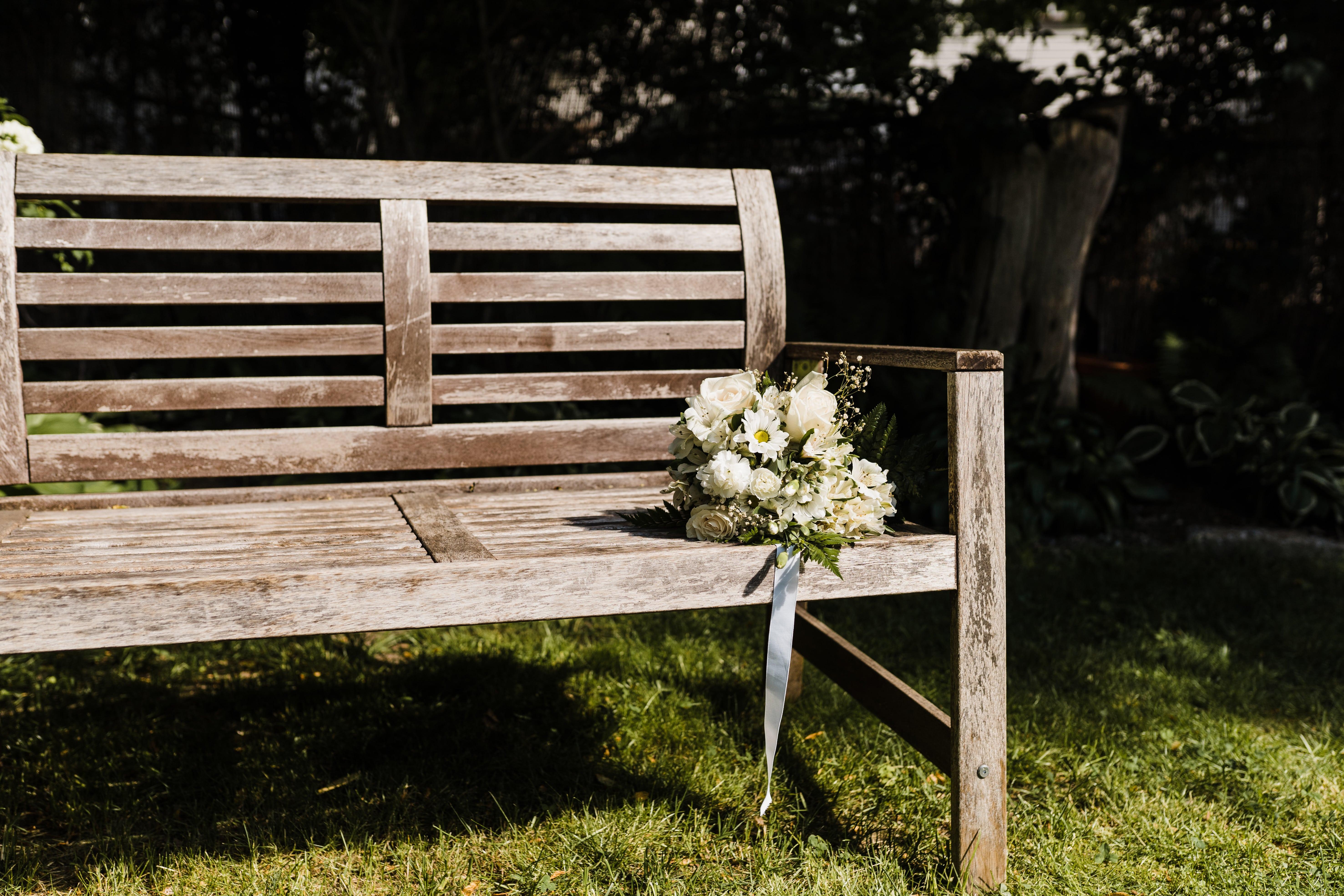 wedding bouquet on an empty bench